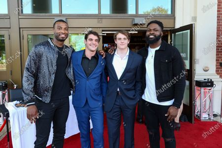 Miles Boykin, wide receiver for the Baltimore Ravens, left, poses with actors RJ Mitte and John Clofine, as well as Otaro Alaka, linebacker for the Baltimore Ravens at the film premiere for 'Triumph'