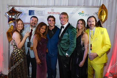 A group poses with RJ Mitte, center