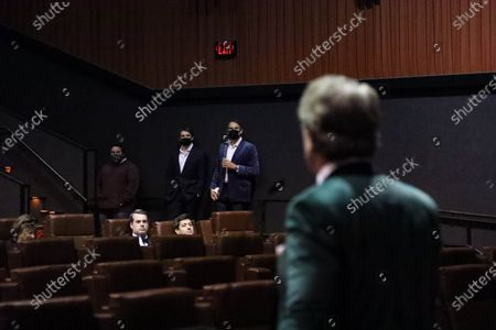 Stock Photo of Steven Scott Stewart speaks to guests as actor John Clofine and his father, producer Michael Clofine look on