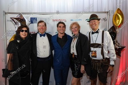 Actor RJ Mitte, center, poses with guests at the film premiere for 'Triumph'