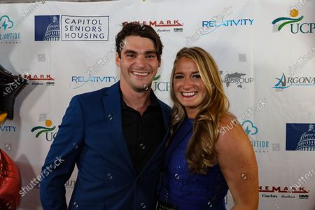 Actor RJ Mitte poses with a woman at the film premiere for 'Triumph'