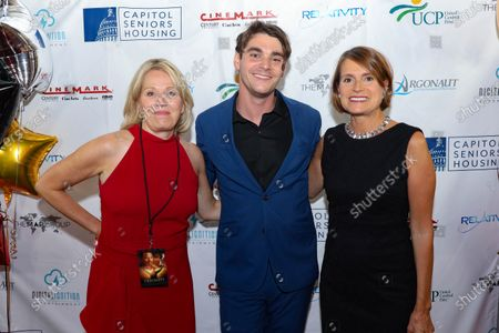 Actor RJ Mitte, center, poses with two guests at the film premiere for 'Triumph'