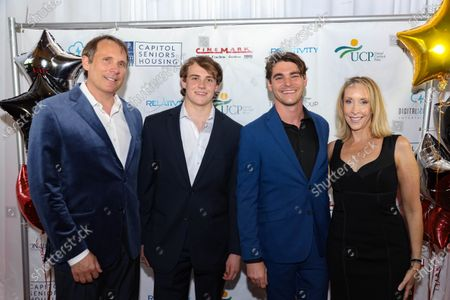 Producer Michael Clofine poses with son John Clofine, actor RJ Mitte and another woman at the film premiere for 'Triumph'