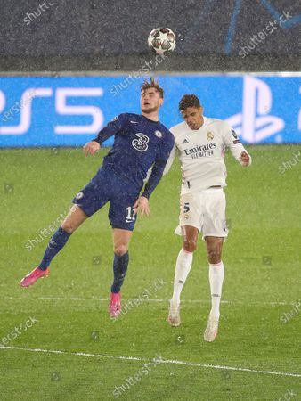 Raphael Varane of Real Madrid in action with Timo Werner of Chelsea FC during the UEFA Champions League Semi Final First Leg match between Real Madrid and Chelsea at Estadio Alfredo Di Stefano in Madrid, Spain, on April 27, 2021.