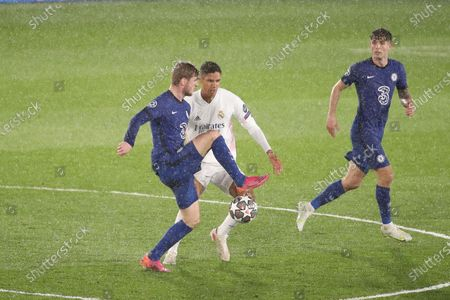 Raphael Varane of Real Madrid in action during the UEFA Champions League Semi Final First Leg match between Real Madrid and Chelsea at Estadio Alfredo Di Stefano in Madrid, Spain, on April 27, 2021.