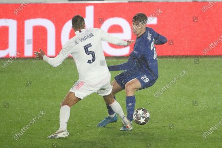 Kai Kavertz in action with Raphael Varane of Real Madrid during the UEFA Champions League Semi Final First Leg match between Real Madrid and Chelsea at Estadio Alfredo Di Stefano in Madrid, Spain, on April 27, 2021.