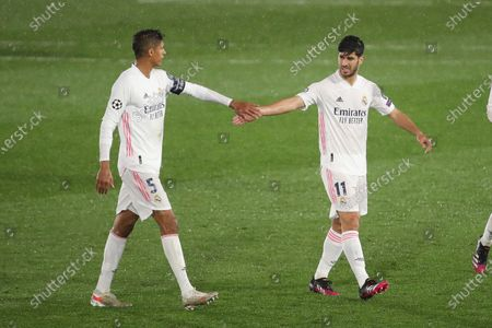 Marco Asensio of Real Madrid with Raphael Varane of Real Madrid during the UEFA Champions League Semi Final First Leg match between Real Madrid and Chelsea at Estadio Alfredo Di Stefano in Madrid, Spain, on April 27, 2021.