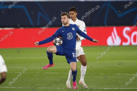 Timo Werner of Chelsea FC in action with Raphael Varane of Real Madrid during the UEFA Champions League Semi Final First Leg match between Real Madrid and Chelsea at Estadio Alfredo Di Stefano in Madrid, Spain, on April 27, 2021.