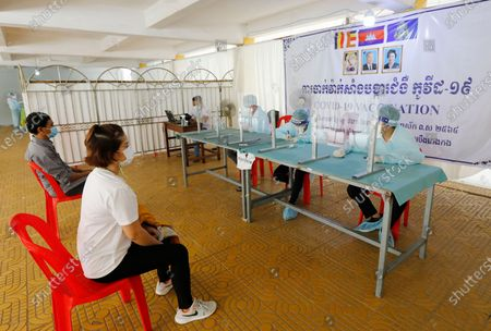 People register to receive a dose of Sinopharm COVID-19 vaccine during a vaccination drive held at a center in Phnom Penh, Cambodia, 28 April 2021. Cambodian Prime Minister Hun Sen on 27 April 2021 ordered a national COVID-19 vaccination campaign for all people aged 18 and over, starting with the lockdown areas 'Red Zone' in Phnom Penh after a spike in Covid-19 cases in the country.