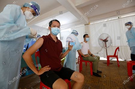 People are injected with a dose of Sinopharm COVID-19 vaccine during a vaccination drive held at a center in Phnom Penh, Cambodia, 28 April 2021. Cambodian Prime Minister Hun Sen on 27 April 2021 ordered a national COVID-19 vaccination campaign for all people aged 18 and over, starting with the lockdown areas 'Red Zone' in Phnom Penh after a spike in Covid-19 cases in the country.