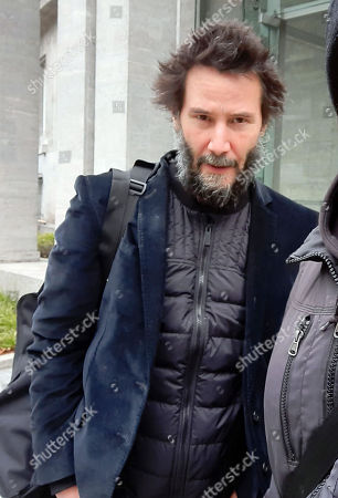 """Stock Photo of Keanu Reeves leaving his hotel for the set of """"John Wick 4"""" for Studio Babelsberg, Potsdam"""