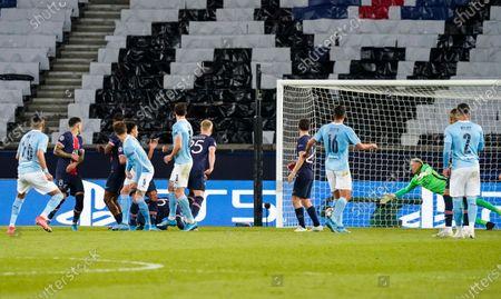 Riyad Mahrez of Manchester City scores a free kick 1-2