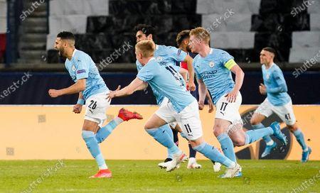 Riyad Mahrez of Manchester City scores and celebrates 1-2