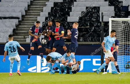 Riyad Mahrez of Manchester City scores from a free kick 1-2