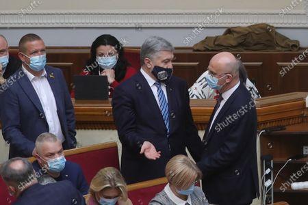 European Solidarity MP Petro Poroshenko (C) attends an extraordinary sitting of the Verkhovna Rada, Kyiv, capital of Ukraine.