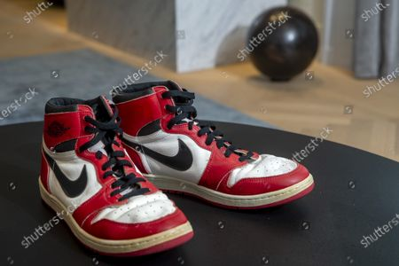 Shoes of former NBA player Michael Jordan Game Worn 1985 Player Sample Air Jordan 1s estimated to sell between 100,000 and 150,000 Swiss francs (CHF), during a Sotheby's preview at the boutique Buchere, in Geneva, Switzerland, 28 April 2021. Sotheby's presents 'Gamers Only', a selective online auction of game-worn sneakers from some of basketball's greatest athletes until 12 May.