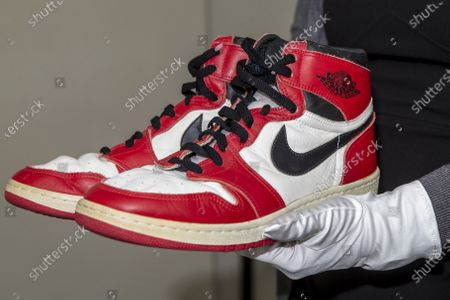 A person shows shoes of former NBA player Michael Jordan Game Worn 1985 Player Sample Air Jordan 1s estimated to sell between 100,000 and 150,000 Swiss francs (CHF), during a Sotheby's preview at the boutique Buchere, in Geneva, Switzerland, 28 April 2021. Sotheby's presents 'Gamers Only', a selective online auction of game-worn sneakers from some of basketball's greatest athletes until 12 May.