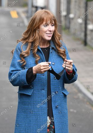 Labour Deputy Leader Angela Rayner puts on a face mask while campaigning at The Factory in Porth, South Wales ahead of the Senedd elections in Wales next week.