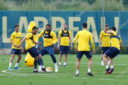 Villarreal FC's French midfielder Francis Coquelin (2L) and defender Raul Albiol (3L) during the training of the team held at the Sports City of Villarreal, Castellon, eastern of Spain on 28 April 2021 on the eve of their UEFA Europa League first leg semifinal match against Arsenal.