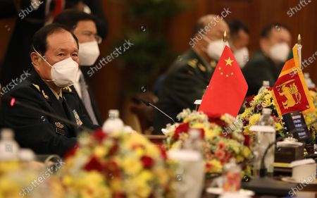 Chinese Defense Minister Wei Fenghe (L) speaks with Siri Lankan Prime Minister Mahinda Rajapaksa (not pictured) during their meeting in Colombo, Sri Lanka, 28 April 2021. Fenghe is on a two-day official visit to Sri Lanka.