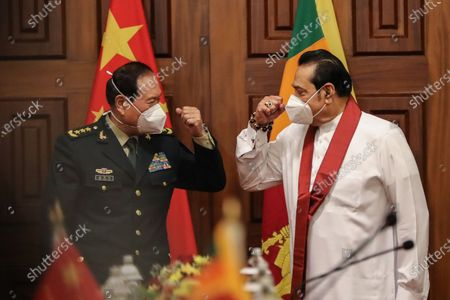 Sri Lankan Prime Minister Mahinda Rajapaksa (R) welcomes Chinese Defense Minister Wei Fenghe (L) during their meeting in Colombo, Sri Lanka, 28 April 2021. Fenghe is on a two-day official visit to Sri Lanka.