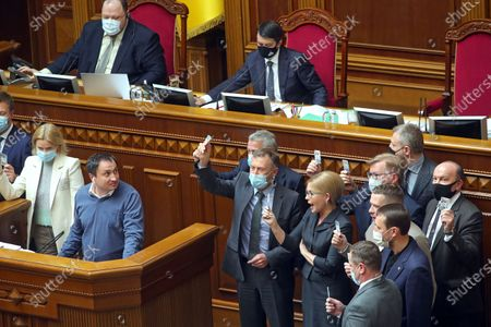 Batkivshchyna faction leader, MP Yulia Tymoshenko (C) and her colleagues are seen at the rostrum during a regular sitting of the Ukrainian parliament, Kyiv, capital of Ukraine.