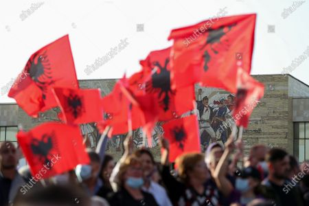 (210428) - TIRANA, April 28, 2021 (Xinhua) - Supporters of Albania's ruling Socialist Party (SP) wave national flags during a rally in Tirana, Albania, April 27, 2021. Albania's ruling SP has won the parliamentary elections held on Sunday for a third term, according to the latest results published by the Central Elections Commission (CEC) early Wednesday.    With over 99 percent of the votes counted, the ruling SP led by Prime Minister Edi Rama has won 48.51 percent or over 750,000 votes at the national level, or 74 seats in the 140-seat parliament, according to the CEC results.