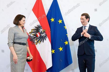 Austrian Chancellor Sebastian Kurz, right, welcomes Belarusian opposition leader Sviatlana Tsikhanouskaya at the federal chancellery in Vienna, Austria