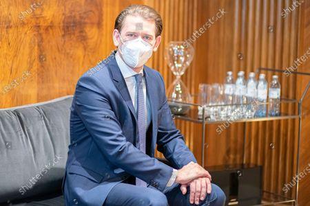 Austrian Chancellor Sebastian Kurz talks to Belarusian opposition leader Sviatlana Tsikhanouskaya, wearing a protective face mask, at the federal chancellery in Vienna, Austria