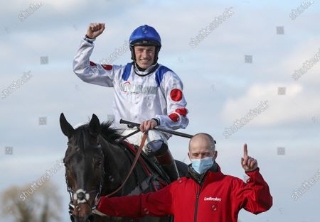 The Ladbrokes Punchestown Gold Cup. Scott Marshall with Sam Twiston-Davies on Clan Des Obeaux after winning