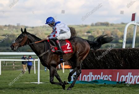 The Ladbrokes Punchestown Gold Cup. Sam Twiston-Davies on Clan Des Obeaux clears the last and comes home to win