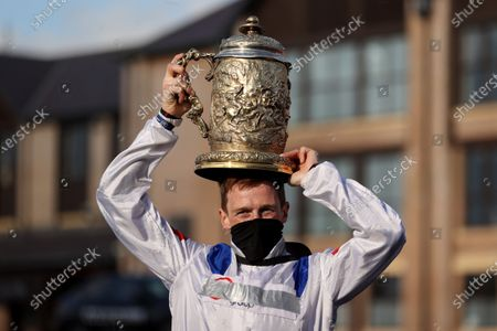 Stock Picture of The Ladbrokes Punchestown Gold Cup. Sam Twiston-Davies lifts the Ladbrokes Punchestown Gold Cup after winning on Clan Des Obeaux