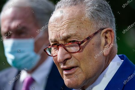 Senate Majority Leader Chuck Schumer, D-N.Y., joined by Sen. Ed Markey, D-Mass., left, talks about legislation to re-impose critical regulations to reduce methane pollution from oil and gas wells, at the Capitol in Washington