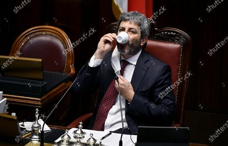Stock Photo of President of Chamber of Deputies Roberto Fico drinks a coffee during a question time session at the Lower House of the Parliament, Rome, Italy, 28 April 2021.