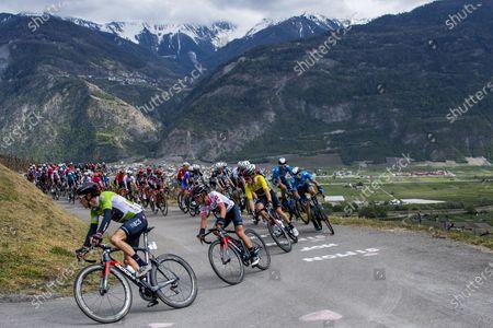 (L-R) British rider Geraint Thomas of team Ineos Grenadiers, Australian rider Richie Porte of team Ineos Grenadiers and Australian rider Rohan Dennis of team Ineos Grenadiers take a turn during the 74th Tour de Romandie cycling tour, a 168 km race between Aigle and Martigny, Switzerland, 28 April 2021.