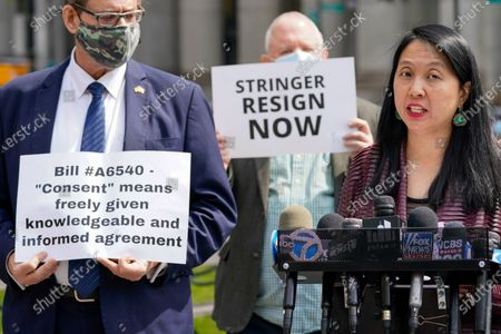 Jean Kim, right, speaks to reporters during a news conference, in New York. Kim, who once worked as an unpaid intern for City Comptroller Scott Stringer, a contender to become New York City's next mayor, accused him Wednesday of groping her without consent. Stringer denied the allegations