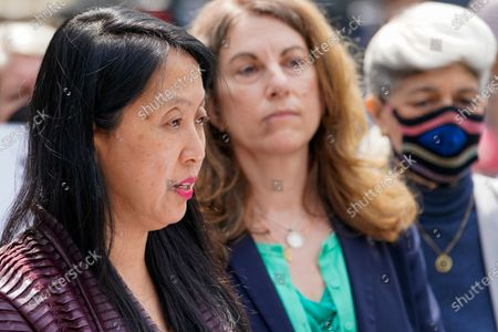 Jean Kim, left, is joined by her attorney Patricia Pastor, center, as she speaks to reporters during a news conference, in New York. Kim, who once worked as an unpaid intern for City Comptroller Scott Stringer, a contender to become New York City's next mayor, accused him Wednesday of groping her without consent. Stringer denied the allegations