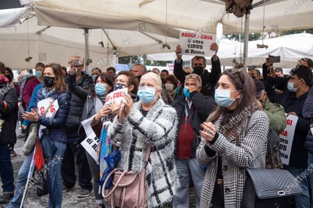 Stock Picture of Demonstration organized by street vendors in Piazza della Repubblica in Rome to protest against the decision of Mayor of Rome Virginia Raggi to apply Bolkestein directive which in Rome would ban about 12 thousand street vendors' licenses.