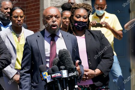 Attornys for the family of Andrew Brown, Wayne Kendall, front, and Chantel Cherry-Lassiter, right, make comments after a judges decision on the release body cam video of the shooting of Andrew Brown Jr. in Elizabeth City, N.C., . A judge denied the request to immediately release body cam video of the incident