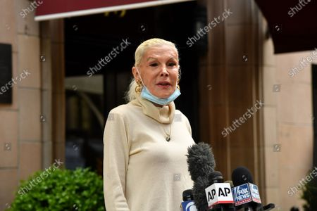 Stock Picture of Michele Herbert speaks to the press in front of Rudy Giuliani's home