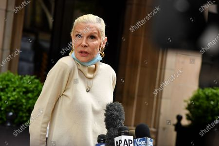 Michele Herbert speaks to the press in front of Rudy Giuliani's home