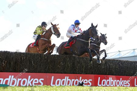 Punchestown Racing Festival, Punchestown Racecourse, Co. Kildare 28/4/2021. The Ladbrokes Punchestown Gold Cup. Sam Twiston-Davies on Clan Des Obeaux jumps ahead of Patrick Mullins on Melon during the race