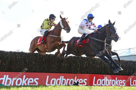Stock Photo of Punchestown Racing Festival, Punchestown Racecourse, Co. Kildare 28/4/2021. The Ladbrokes Punchestown Gold Cup. Sam Twiston-Davies on Clan Des Obeaux jumps ahead of Patrick Mullins on Melon during the race