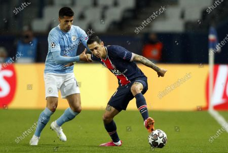 Manchester City's Fernandinho (L) and Paris Saint Germain's Angel Di Maria (R) in action during the UEFA Champions League semi final, first leg soccer match between PSG and Manchester City at the Parc des Princes stadium in Paris, France, 28 April 2021.
