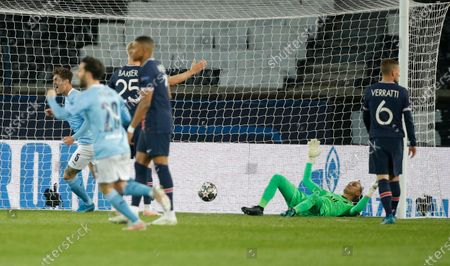 PSG goalkeeper Keylor Navas (bottom) reacts after conceding the 1-1 goal during the UEFA Champions League semi final, first leg soccer match between PSG and Manchester City at the Parc des Princes stadium in Paris, France, 28 April 2021.