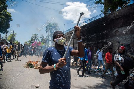Stock Picture of Haitian students protest against the draft Constitution promoted by President Jovenel Moise and against the wave of violence and kidnappings that is shaking the country, in Port-au-Prince, Haiti, 28 April 2021. President Moise intends to submit his projected new Constitution to a popular vote at the end of June, but the opposition refuses to participate in the process.