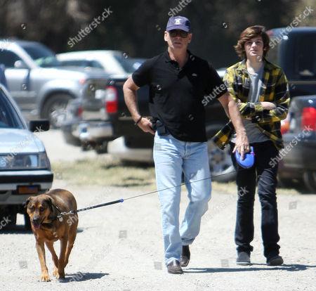 Stock Picture of Pierce Brosnan, pet dog and  Dylan Thomas Brosnan
