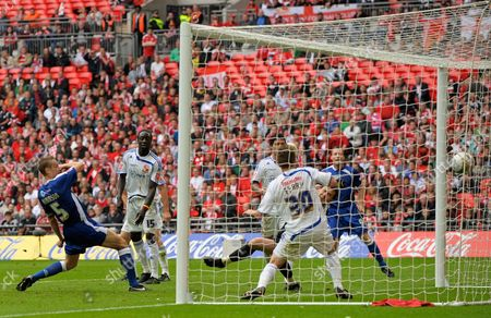 Paul Robinson of Millwall scores past Swindon Town goalkeeper David Lucas, 1-0