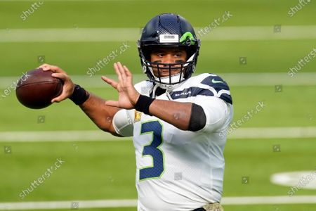 Seattle Seahawks quarterback Russell Wilson (3) warms up before an NFL football game against the Los Angeles Rams in Inglewood, Calif. Seattle Seahawks coach Pete Carroll and general manager John Schneider spend Wednesday, April 28, 2021 talking about their relationship with their starting quarterback, the result of months of silence on the subject and the fact they have just three picks in the NFL draft