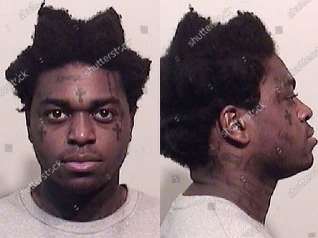 These photos provided by the Niagara County Sheriff's Office shows Bill Kapri, also known as Kodak Black. Rapper Kodak Black was sentenced to probation for assaulting a teenage girl in a South Carolina hotel room